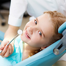 Smiling girl in the dental chair